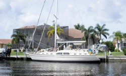Water depths, canal system layout, and canal exits to the harbor are all important considerations when buying a sailboat-access home or lot.