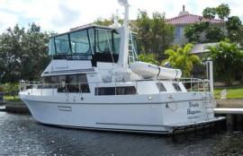 Motor yacht moored at dock in backyard.