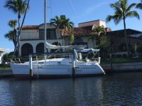 Beneteau on boat lift on Rim Canal